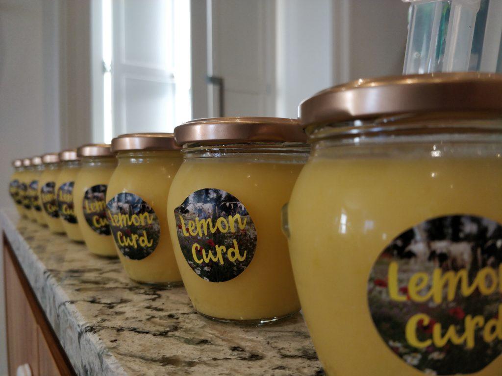 Jars of lemon curd on marble counter top