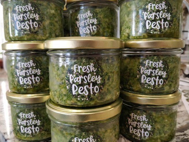 stacks of jars with fresh parsley pesto